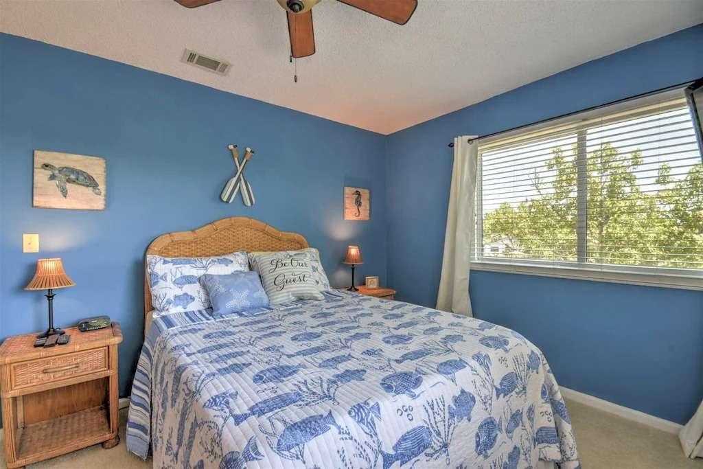 Guest bedroom with queen bed in Amelia Island vacation rental