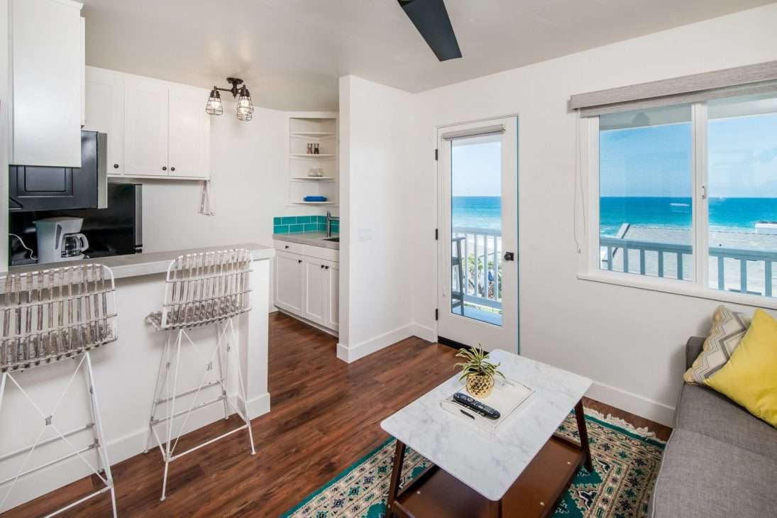Kitchen and living space in Pacific Villas in Oceanside, California