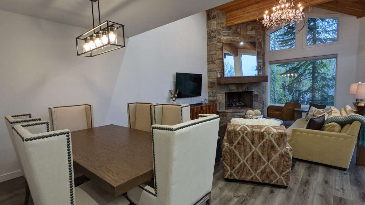Open living space with dining table, couches, chairs and fireplace