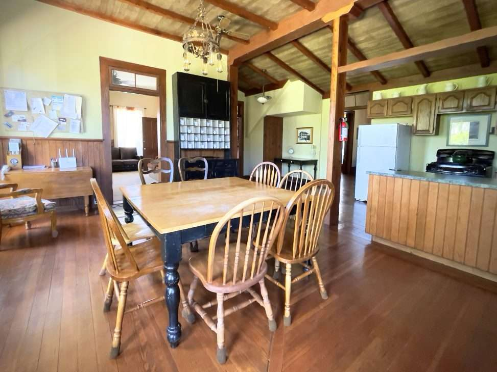 dining room, kitchen and workroom of Historic Collier Hotel vacation rental in Edna, CA