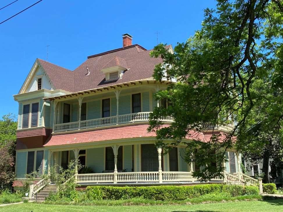 Historic home with wraparound porch in Bastrop, TX
