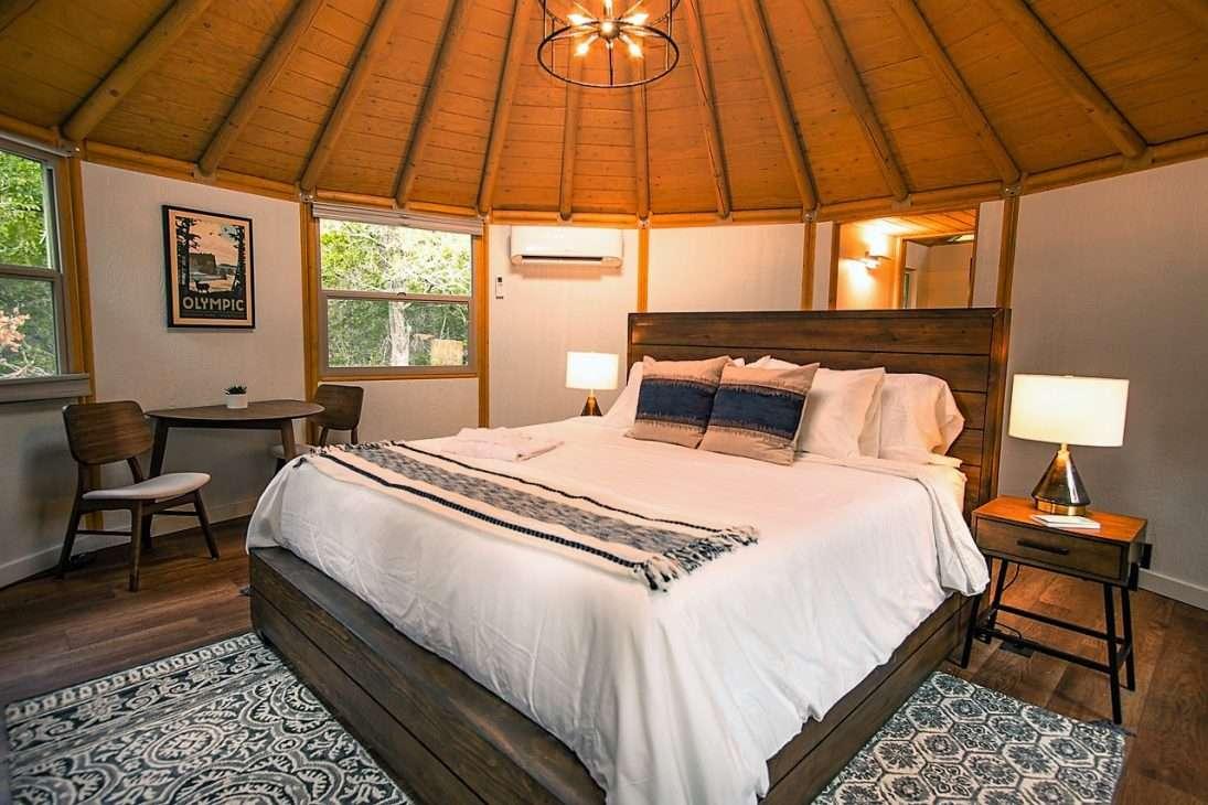 bedroom area of luxury yurt rental in Bastrop, Texas