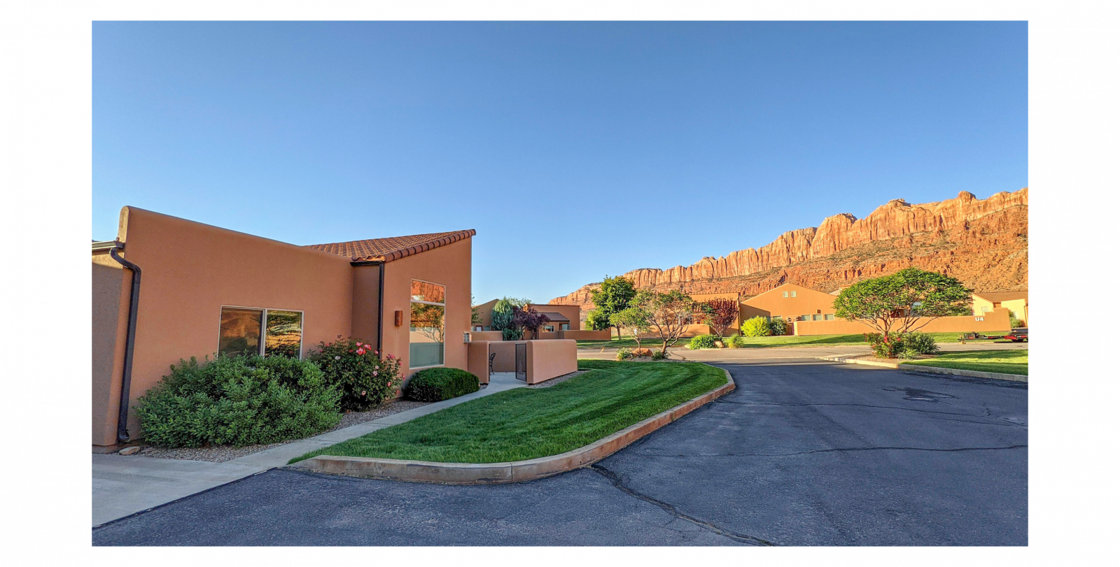 Moab family vacation rental condo exterior with red rocks